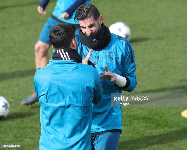 Kiko Casilla and Marco Asensio of Real Madrid looks on during a training session at Valdebebas training ground ahead their Round of 16 first leg UEFA...