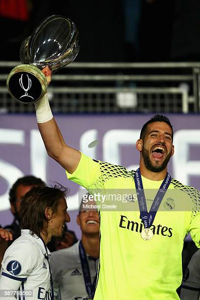 Kiko Casilla of Real Madrid lifts the trophy following victory in the UEFA Super Cup match between Real Madrid and Sevilla at Lerkendal Stadion on...