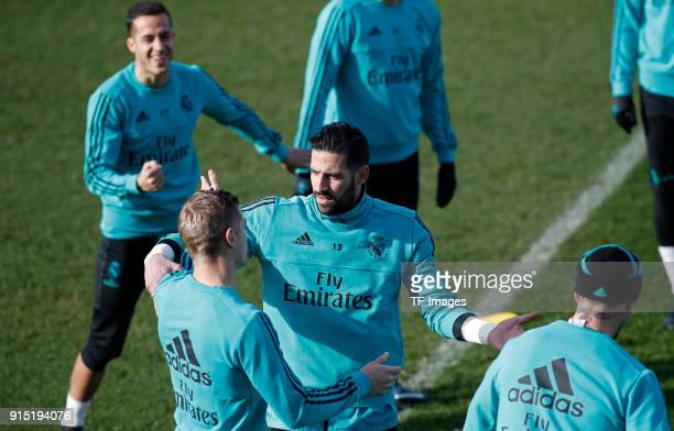 Kiko Casilla of Real Madrid Toni Kroos of Real Madrid and Lucas Vazquez of Real Madrid gesture during a training session at Valdebebas training...