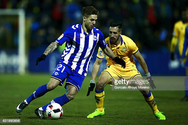 Kiko Femenia of Deportivo Alaves competes for the ball with Daniel Toribio of Agrupacion Deportivo Alcorcon during the Copa del Rey quarterfinal...