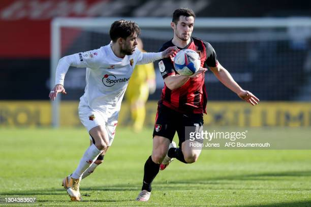 Kiko Femenia of Watford and Lewis Cook of Bournemouth tussle for the ball during the Sky Bet Championship match between AFC Bournemouth and Watford...