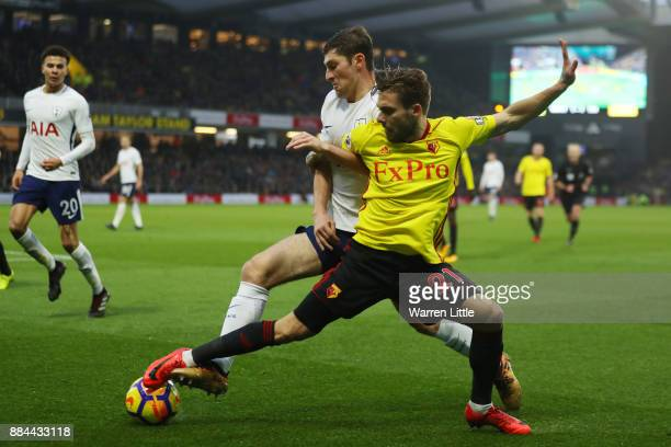 Kiko Femenia of Watford is challenged by Ben Davies of Tottenham Hotspur during the Premier League match between Watford and Tottenham Hotspur at...