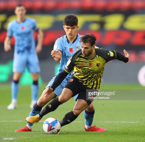 Kiko Femenia of Watford is challenged by Ryan Giles of Coventry City during the Sky Bet Championship match between Watford and Coventry City at...