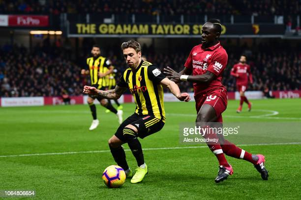 Kiko Femenia of Watford is challenged by Sadio Mane of Liverpool during the Premier League match between Watford FC and Liverpool FC at Vicarage Road...