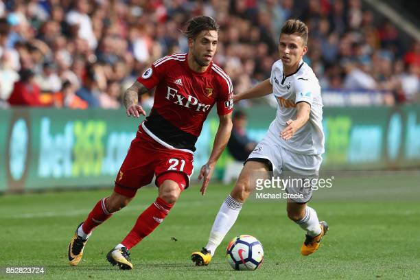 Kiko Femenia of Watford is tracked by Tom Carroll of Swansea City during the Premier League match between Swansea City and Watford at Liberty Stadium...