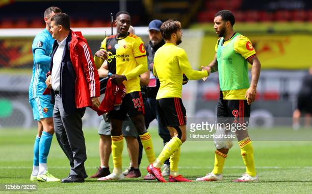 Kiko Femenia shakes hands with team mate Troy Deeney of Watford following the Premier League match between Watford FC and Newcastle United at...