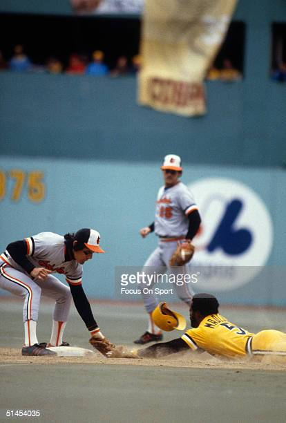 Kiko Garcia of the Baltimore Orioles tags out sliding Pitsburg Pirate Bill Madlock during the World Series at Memorial Stadium in Baltimore Maryland...