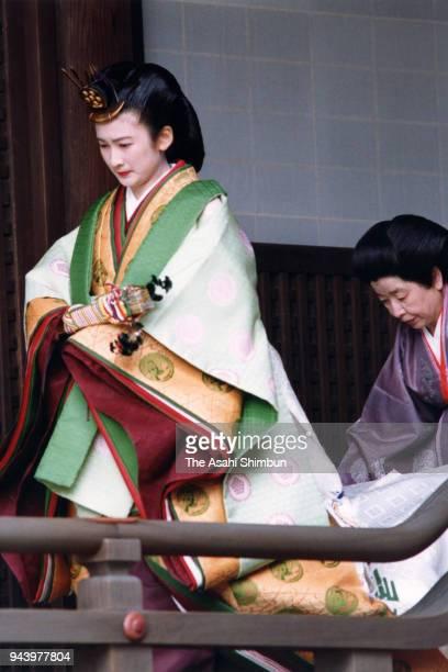 Kiko Kawashima in traditional Juni-Hitoe kimono arrives at the Kashikodokoro sanctuary during the 'Kekkon-no-Gi' wedding ceremony with Prince...