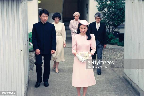 Kiko Kawashima is seen off by her parents Tatsuhiko Kazuyo and younger brother Shu prior to the 'KekkonnoGi' wedding ceremony with Prince Fumihito on...