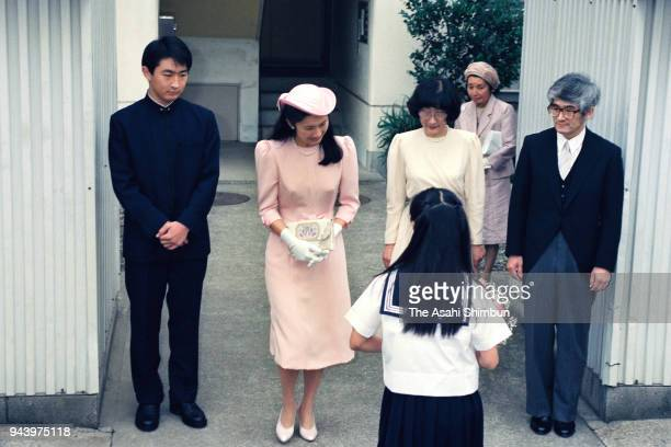 Kiko Kawashima receives a flower bouquet prior to the 'KekkonnoGi' wedding ceremony with Prince Fumihito in front of her home on June 29 1990 in...
