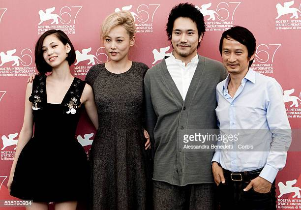 Kiko Mizuhara Rinko Kikuchi Kenichi Matsuyama and Director Tran Anh Hung attend the photocall of movie Norwegian Wood presented in competition at the...