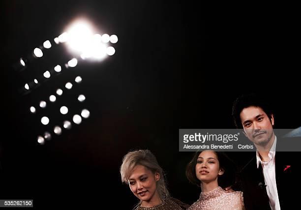 Kiko Mizuhara Rinko Kikuchi Kenichi Matsuyama attend the photocall of movie Norwegian Wood presented in competition at the 67th Venice Film Festival