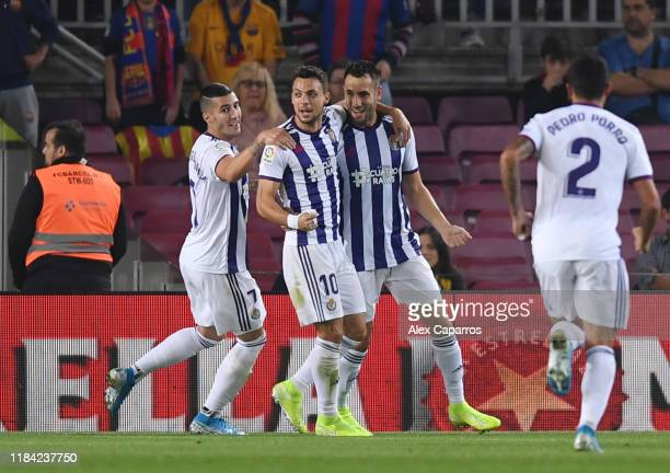 Kiko of Valladolid celebrates with teammates after scoring his team's first goal during the Liga match between FC Barcelona and Real Valladolid CF at...