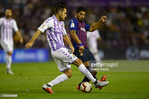 Kiko Olivas of Valladolid competes for the ball with Luis Suarez of Barcelona during the La Liga match between Real Valladolid CF and FC Barcelona at...