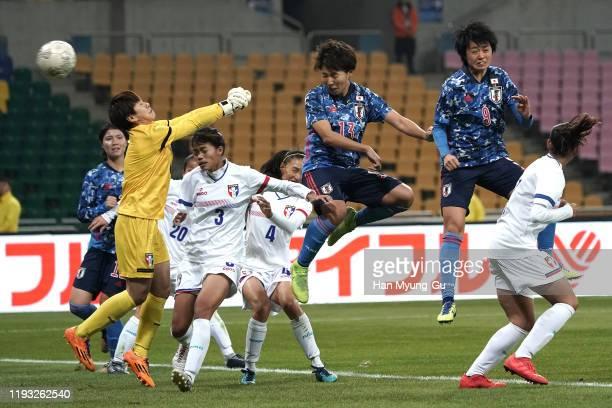Kiko Seike of Japan scoring the 8th goal during the EAFF E-1 Football Championship match between Japan and Chinese Taipei at Busan Asiad Main Stadium...