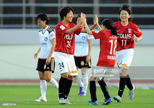 Kiko Seike of Urawa Reds Ladies celebrates scoring her team's first goal with her team mate Hanae Shibata during the Nadeshiko League match between...