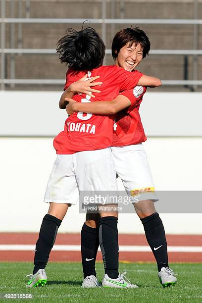 Kiko Seike of Urawa Reds Ladies celebrates scoring her team's second goal with her team mate Shiho Kohata during the Nadeshiko League match between...