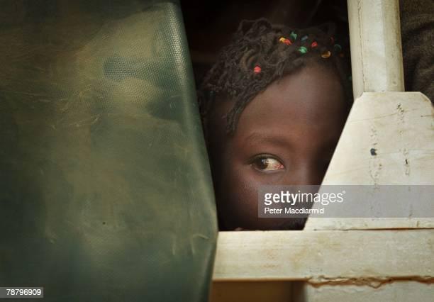 Kikuyu girl looks out of a truck as she arrives at the Nakuru show ground on January 7, 2008 in Nakuru, Kenya. Local volunteers and charities are...