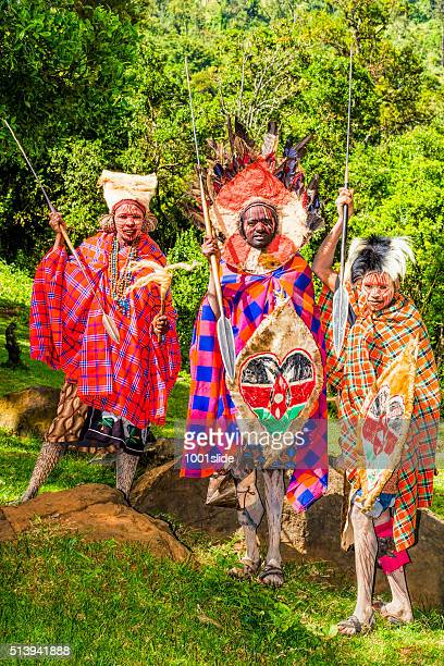 kikuyu warriors wearing traditional ornaments - african witch doctor stock photos and pictures