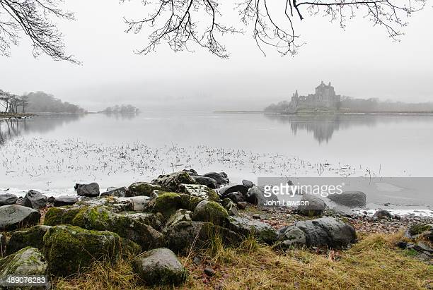 Kilchurn Castle, Argyll and Bute, Scotland viewed across a frozen Loch Awe.