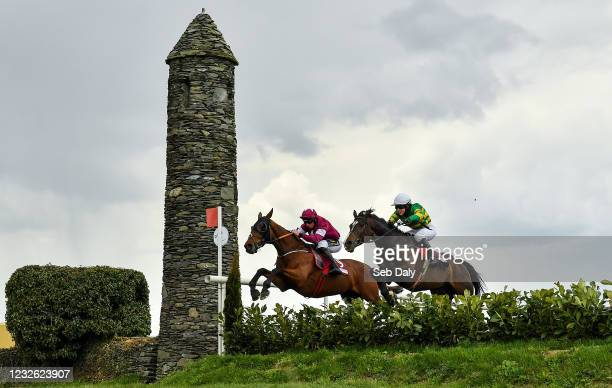 Kildare , Ireland - 1 May 2021; Alpha Des Obeaux, left, with Jamie Codd up, and Josies Orders, with Phidelma Elvin up, jump the Glendalough drop...