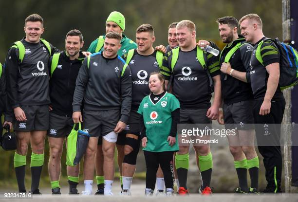 Kildare Ireland 15 March 2018 Jennifer Malone from Clane County Kildare poses for a photo with players from left Jacob Stockdale John Cooney Jordan...