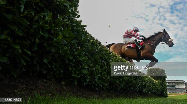 Kildare , Ireland - 17 November 2019; Like A Demon, with Luke McGuinness up, jump the third during the EMS Copiers Risk Of Thunder Steeplechase at...
