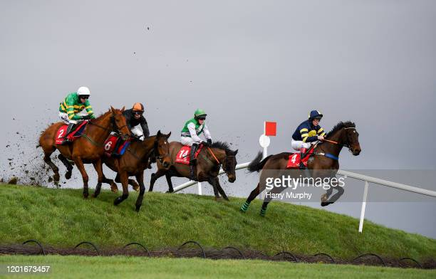 Kildare Ireland 18 February 2020 Runners and Riders including Ard Na Carraig with Barry Browne up right jump Ruby's Double during the PP Hogan...