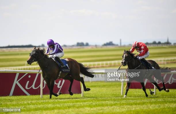 Kildare , Ireland - 18 July 2021; Order of Australia, with Ryan Moore up, left, on their way to winning the Romanised Minstrel Stakes ahead of...