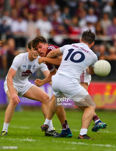 Kildare Ireland 22 July 2018 Eamonn Brannigan of Galway scores a point under pressure from David Hyland of Kildare during the GAA Football AllIreland...