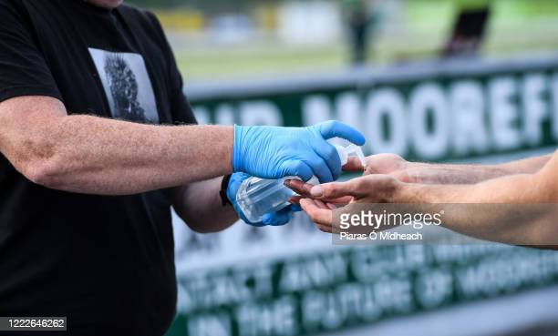 Kildare , Ireland - 24 June 2020; Cully Hayden, Covid Supervisor, gives hand sanitiser to a player before a Moorefield Senior Football Squad training...