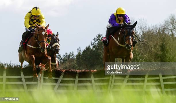 Kildare Ireland 25 April 2017 Cilaos Emery right with David Mullins up jump the last alongside Melon with Ruby Walsh up who finished second and...