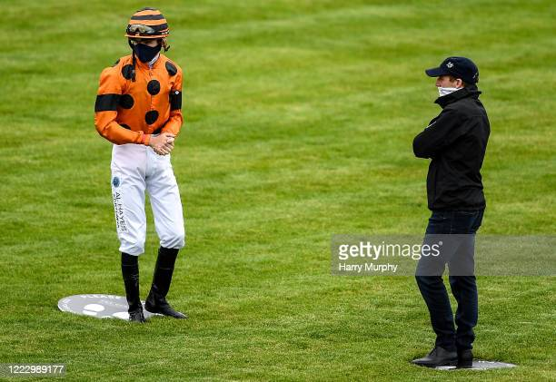 Kildare Ireland 26 June 2020 Trainer Johnny Murtagh talks to jockey Ben Martin Coen ahead of the Irish Stallion Farms EBF Fillies Maiden during day...