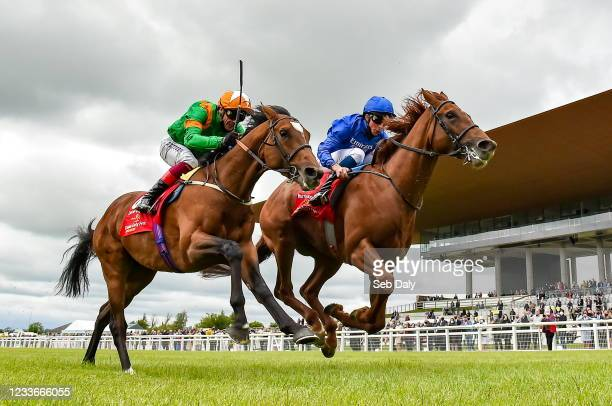 Kildare , Ireland - 26 June 2021; Hurricane Lane, right, with William Buick up, on their way to winning the Dubai Duty Free Irish Derby, from second...