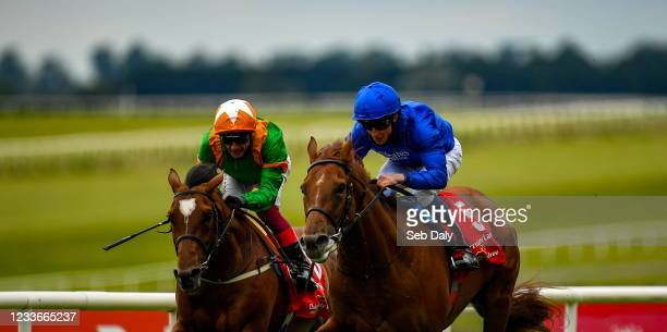 Kildare , Ireland - 26 June 2021; Hurricane Lane, with William Buick up, right, on their way to winning the Dubai Duty Free Irish Derby, from second...