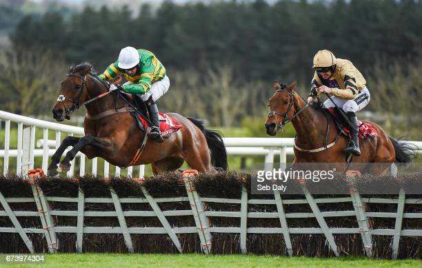 Kildare Ireland 27 April 2017 Unowhatimeanharry left with Noel Fehily up jump the last alongside Nichols Canyon with Ruby Walsh up who finished...