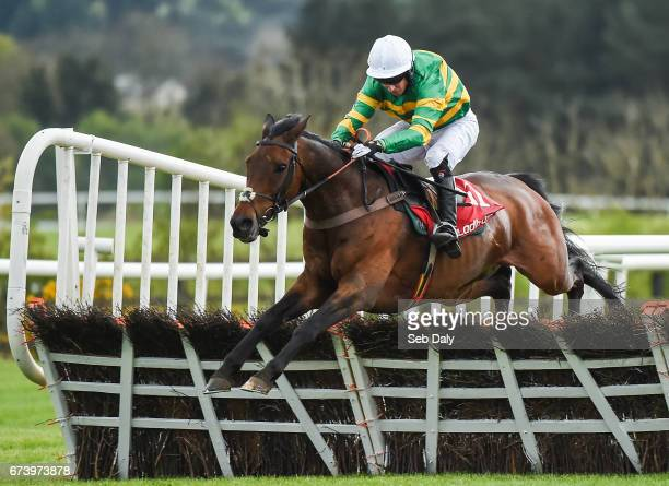 Kildare Ireland 27 April 2017 Unowhatimeanharry with Noel Fehily up jump the last on their way to winning the Ladbrokes Champion Stayers Hurdle at...