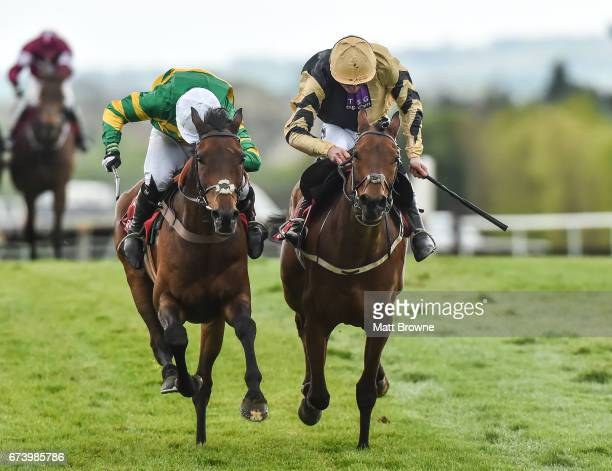 Kildare Ireland 27 April 2017 Unowhatimeanharry with Noel Fehily up on their way to winning the Ladbrokes Champion Stayers Hurdle from second place...