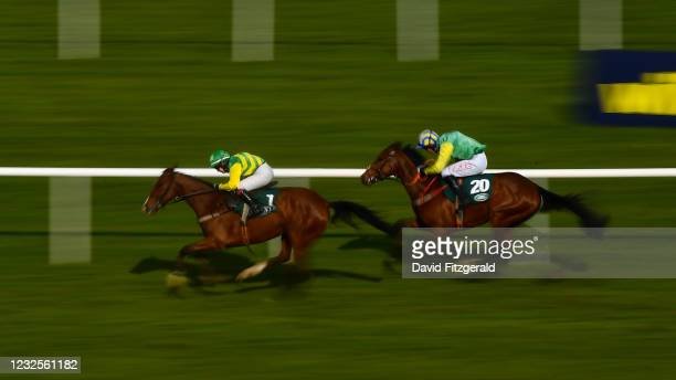 Kildare , Ireland - 27 April 2021; Adamantly Chosen, with Jody Townend up, race up the home straight ahead of eventual second Springwell Bay, Derek...