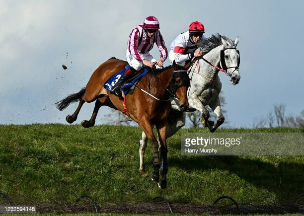 Kildare , Ireland - 29 April 2021; Space Cadet, left, with Ricky Doyle up, and Some Neck, with Ben Harvey up, jump Ruby's Double during the Mongey...