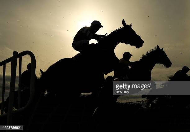 Kildare Ireland 29 September 2020 Handsworth with Niall Madden up jumps the first during the Exhibit A Displays Handicap Hurdle at Punchestown...