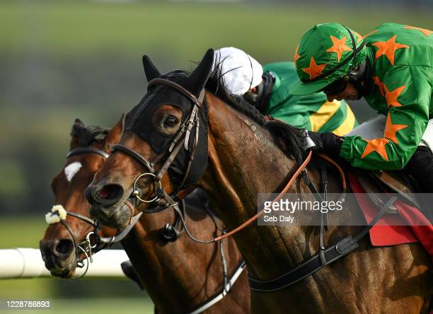 Kildare Ireland 29 September 2020 Rebel Gold near with Paddy Kennedy up races alongside eventual second place Winner Takes Itall behind with Mark...
