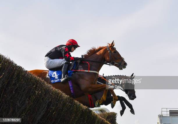 Kildare Ireland 29 September 2020 Shumaker near with Darragh O'Keeffe up jumps the last alongside eventual second place Dakota Moirette with Jack...
