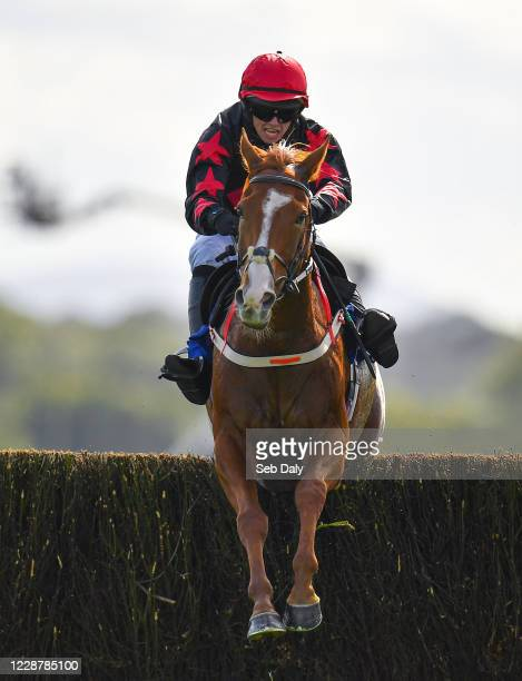 Kildare Ireland 29 September 2020 Shumaker with Darragh O'Keeffe up jumps the last on their way to winning the Close Brothers Beginners Steeplechase...