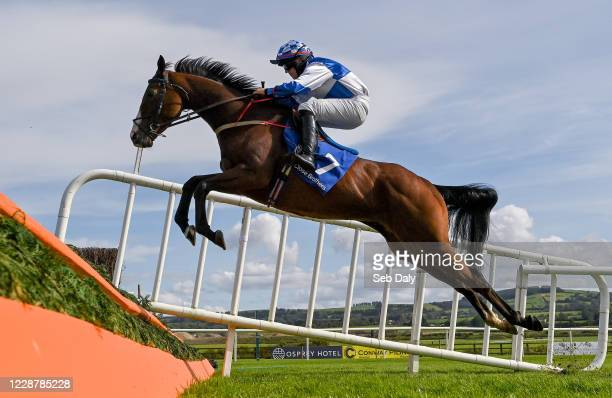 Kildare Ireland 29 September 2020 Silver Star with Denis O'Regan up jumps the second during the Close Brothers Beginners Steeplechase at Punchestown...