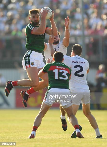 Kildare Ireland 30 June 2018 Aidan OShea of Mayo catches a kickout ahead of teammate Jason Doherty and Kildare players Fergal Conway behind and Peter...