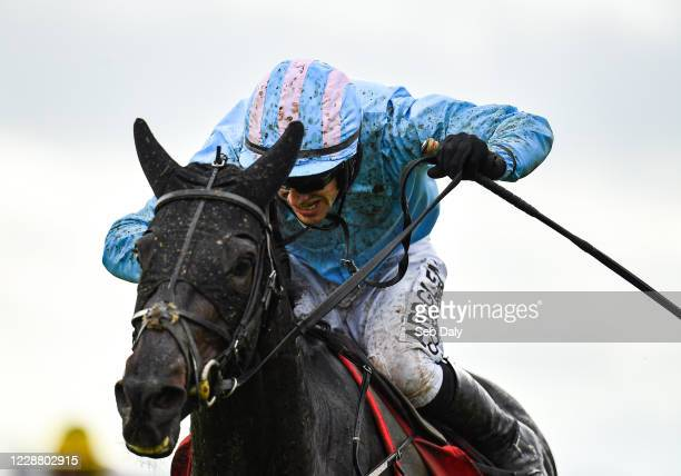 Kildare , Ireland - 30 September 2020; Jockey Brian Hayes, and mount The Shunter, on their way to winning the SalesSense Beginners Steeplechase at...
