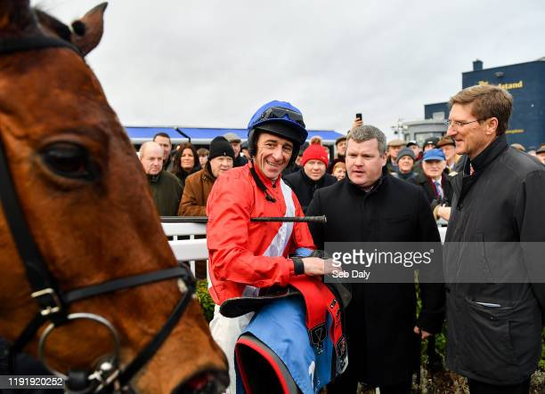 Kildare Ireland 5 January 2020 Jockey Davy Russell left trainer Gordon Elliott centre and representative owner Chris Hitchens in conversation in the...