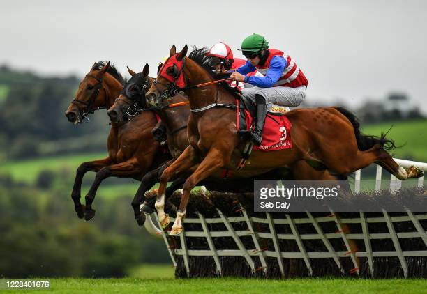 Kildare Ireland 8 September 2020 Bigz Belief right with Dillon Maxwell up jumps the third alongside Sister Eliza left with Denis O'Regan up Poets...