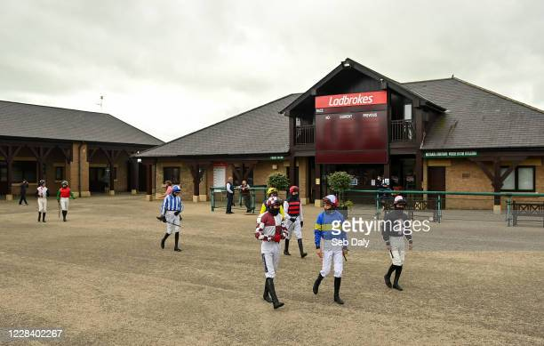 Kildare Ireland 8 September 2020 Jockeys from right Shane Mulcahy Danny Mullins and Keith Donoghue make their way to the parade ring prior to the...